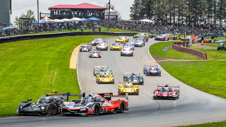 IMSA cars come through the esses at Mid-Ohio Sports Car Course