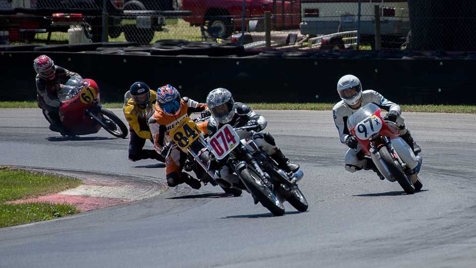vintage motorcycles race around the Mid-Ohio Sports Car Course
