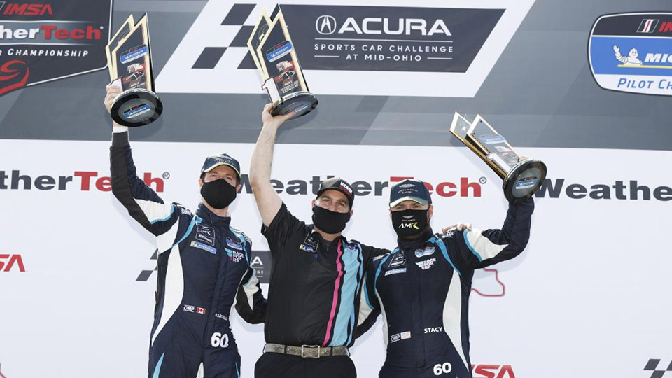 Michelin Pilot Challenge Race 2 winners on the podium at Mid-Ohio Sports Car Course